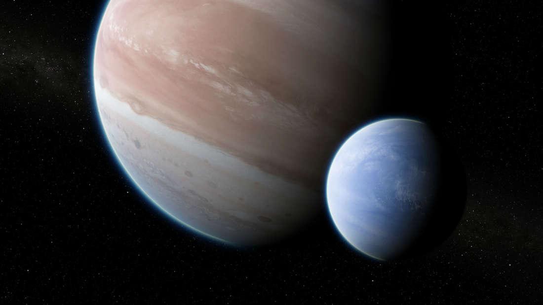 exoplaneta Kepler-1625b con su presunta luna.