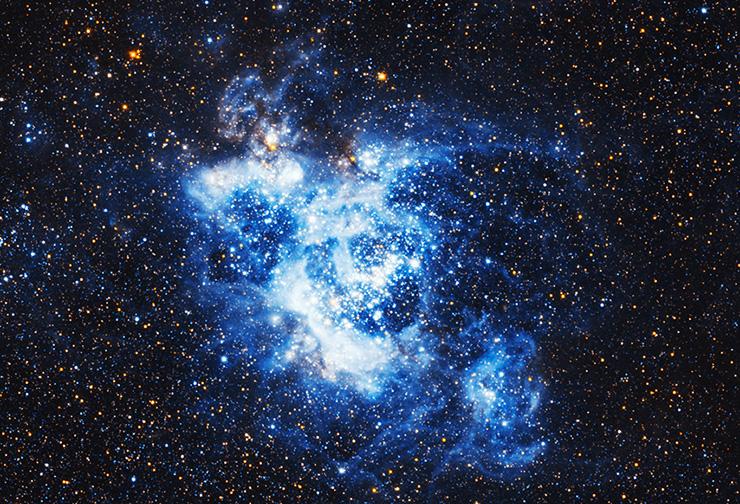 NGC 604, una gigantesca nube de gas y polvo cósmico ubicado en Triangulum