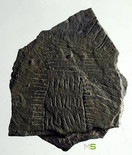 Fragmento de un disco de piedra