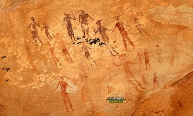 Pinturas rupestres de Tassili que muestran humanoides con cabezas de gran tamaño junto a humanos